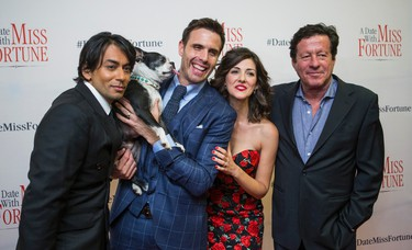 Vik Sahay (from left), Ryan Scott (holding Bella the Boston Terrier), Jeannette Sousa, and Joaquim De Almeida at the red carpet for the Canadian romantic comedy A Date With Miss Fortune for the premiere at Cineplex Cinemas Yonge Dundas & VIP in Toronto, Ont.  on Thursday January 28, 2016. Ernest Doroszuk/Toronto Sun/Postmedia Network