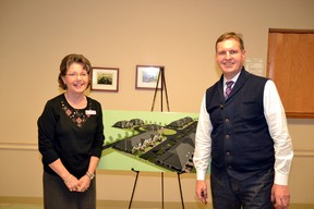 Real estate agent Michelle Chessell (left) and developer Michael Van Pelt pose with a concept site design sketch for the proposed Upper Thames Village at an information meeting in the Mitchell Golf and Country Club Jan. 27. GALEN SIMMONS/MITCHELL ADVOCATE