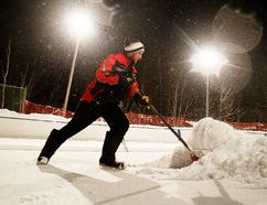 Gino Donato/Sudbury Star Rink supervisor Marc Gagnon shovels the ice surface at the East End playground rink in this file photo.
