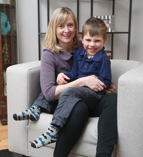 Stephanie Millius and her son Brendan, who just turned 5, and has nine teachers and early childhood educators in his kindergarten class. (Jean Levac/Postmedia)