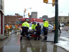 Multiple people were injured after two vehicles collided in the intersection of Horton and Wellington streets shortly after 2:30 p.m. Sunday.  MARY JANE EGAN / THE LONDON FREE PRESS