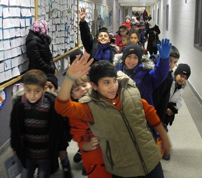 Government-assisted Syrian refugee children leave to go back to the Cross Cultural Learner Centre after a day at a special welcome centre for them at White Oaks public school in London. The Thames Valley District school board welcome centre assesses families? literacy and numeracy levels and introduces them to school life in Canada. (KATE DUBINSKI, The London Free Press)