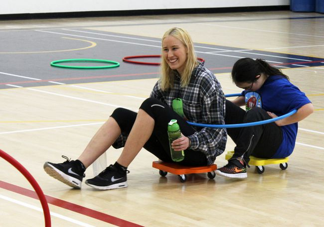 Shannen Murray, left, and Ashaya Garrett play during the 26th Annual Winter Adaptive Games at Queen's University's Athletics and Recreation Centre on Saturday. (Steph Crosier/The Whig-Standard)
