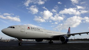 A Delta Airlines plane is seen in this Jan.  2, 2013, file photo. REUTERS/Jeff Haynes/Files