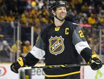 Pacific Division forward John Scott looks into the stands during the NHL All-Star Game against the Atlantic Division at Bridgestone Arena in Nashville on Jan. 31, 2016. (AP Photo/Mark Humphrey)