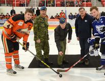 4 Wing Commanding Officer Col. Eric Kenny drops the puck for the ceremonial faceoff during Military Appreciation Night at the Cold Lake Ice home game on Friday January 29, 2016 in Cold Lake, Alta. Peter Lozinski/Cold Lake Sun/Postmedia Network