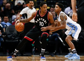 Toronto Raptors guard DeMar DeRozan (10) dribbles the ball while being defended by Denver Nuggets guard Gary Harris (14) in the first quarter Monday at Pepsi Center in Denver. (Isaiah J. Downing/USA TODAY Sports)