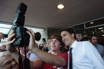 A young Liberal supporter takes a selfie with Liberal Leader Justin Trudeau during a rally on Monday, August 24, 2015 in Peterborough, Ont. THE CANADIAN PRESS/Paul Chiasson