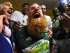 Portland Timbers defender Nat Borchers (7) gets his beard cut in the locker room after the 2015 MLS Cup championship game against the Columbus Crew at MAPFRE Stadium. Mike DiNovo-USA TODAY Sports