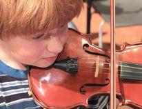 Max is one of the children benefitting from the El Sistema music learning program.