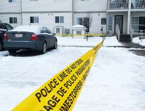 Police tape cordoned off the parking lot at the Birch Terrace apartment complex following an officer-involved shooting March 24, 2015