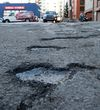 Potholes are already visible in an alley south of Jasper Avenue and 119 Street, in Edmonton Alta. on Wednesday Feb. 3, 2016. Photo by David Bloom