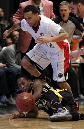 London Lightning?s Mustafaa Jones hits the floor going after the ball ahead of Windsor Express guard Adrian Moss during the Clash at the Colosseum at Caesars Windsor on Wednesday night. (TYLER BROWNBRIDGE/The Windsor Star)