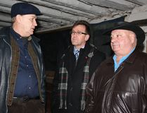 Raw milk advocate Michael Schmidt, left, speaks with Bruce-Grey-Owen Sound MPP Bill Walker, centre and Bruce-Grey-Owen Sound MP Larry Miller in the barn at Glencolton Farms, near Durham, Ont. on Wednesday, Feb. 3, 2016. Miller called on Ontario to regulate the sale of raw milk after the tour while Walker called for the matter to be studied. (Don Crosby/For The Sun Times)