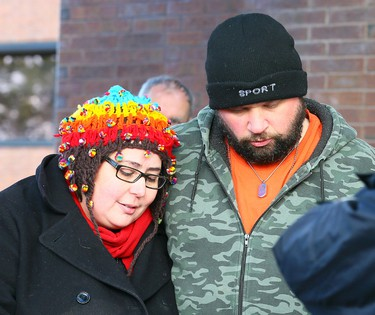 Jennifer Neville-Lake is comforted by her husband Edward Lake after Muzzo pleaded guilty and posted 1 million dollar bail until his Feb 23rd sentencing in Newmarket Court on Thursday February 4, 2016. Dave Abel/Toronto Sun/Postmedia Network