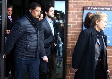 Marco Muzzo leaves court with his mom and his fiancee after pleading guilty and posted 1 million dollar bail until his Feb 23rd sentencing in Newmarket Court on Thursday February 4, 2016. Dave Abel/Toronto Sun/Postmedia Network