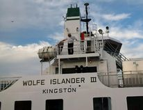 Supplied Photo Brian Johnson stands on the bridge wing of the refurbished Wolfe Islander III, departing Hamilton for Kingston on Nov. 7, 2015.