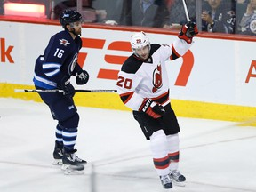 Devils forward Lee Stempniak (right) celebrates his goal as Jets forward Andrew Ladd (left) skates by during NHL action in Winnipeg on Jan. 23, 2016. (John Woods/THE CANADIAN PRESS)