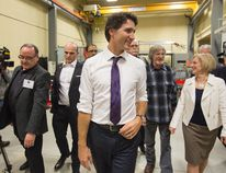 Prime Minister Justin Trudeau, centre, and Alberta Premier Rachel Notley, right, tour the International Brotherhood of Electrical Workers training facility in Edmonton, Alberta, on Wednesday February 3, 2016. THE CANADIAN PRESS/Amber Bracken