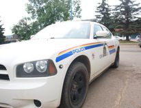A Wood Buffalo RCMP patrol car parked in downtown Fort McMurray on Monday June 22, 2015. Andrew Bates/Fort McMurray Today/Postmedia Network