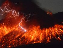 In this photo taken with a 15-second exposure by a fixed-position camera in Ushinefumoto in Tarumizu, Kagoshima Prefecture, lightning flashes above flowing lava as Sakurajima, a well-known volcano, erupts Friday evening, Feb. 5, 2016 in southern Japan. Japan's Meteorological Agency said Sakurajima on the island of Kyushu erupted at around 7 p.m. (1000 GMT). The distance between Sakurajima and Ushinefumoto is about 9 kilometers (5.6 miles). (Kyodo News via AP)