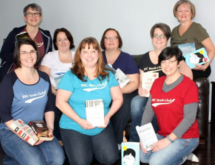 Best Book Club members are: (front, left to right) Amanda Hicks Moss, Jennifer Dawn Mathison and Sue Stephenson-Shaw. (seated, left to right) Melanie Bryant, Heather Littleton (Fred Park) and Erin McArthur Ferlaino. (back left) Marla Adamson Barber and (back right) Heather MacDonald-Gjos (Mac-G).