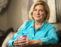 <p>Carol Anne Meehan, who was unceremoniously laid off from her long-time job as news anchor at CTV Ottawa, curls up on the couch with a coffee, at her home near Manotick on Thursday December 03, 2015.</p><p> Darren Brown/Ottawa Citizen/Postmedia Network