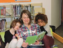 Helena Kwantes reads to daughter Mara, 8, left, and Ethan Ogwu, 5, during the Edson Library Public Library Literacy Days and Birthday event Jan. 30. The event drew impressive crowds.