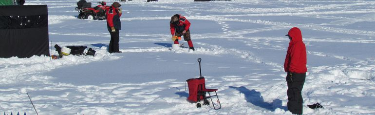 Anglers set up on Sarnia Bay for ice fishing in this 2014 file photo. Ongoing winter warm snaps this year and low ice levels have lead the Bluewater Anglers to cancel their annual ice fishing derby. (File photo)