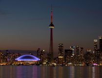 FILE - In this July 26, 2015 file photo, the sun sets over the CN Tower and Rogers Centre during the closing ceremonies of the Pan Am Games in Toronto. Toronto's attractions are getting an extra dose of attention because the city is hosting the 2016 NBA All-Star game. (AP Photo/Rebecca Blackwell, File)