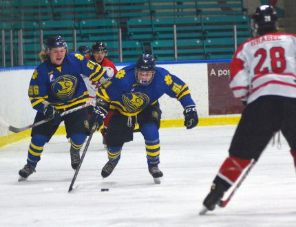 Norfolk Vikings forwards Charlie Yelkin and Pyry Karttunen skate with the puck while London Lakers defenceman Chris Hrabec skates in anticipation during a GMHL junior A hockey game on Thursday, Feb. 4, 2016 at Talbot Gardens in Simcoe. London defeated Norfolk 5-2. (EDDIE CHAU Simcoe Reformer)