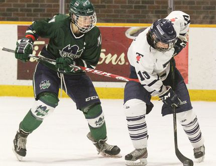Nipissing Lakers captain Carly Marchment (11) takes on a Toronto player in this Nugget file photo of OUA women's hockey action at Memorial Gardens. The Lakers women and men host double-headers tonight and tomorrow. Dave Dale/The Nugget