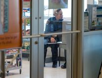 A London Police officer takes a witness statement following an attempted robbery at a Shoppers Drug Mart at 460 Springbank Drive in London on Wednesday. Craig Glover/The London Free Press/Postmedia Network