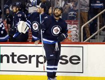 Winnipeg Jets defenseman Dustin Byfuglien (33) looks up at the scoreboard replay after he scores against the Dallas Stars during the third period at MTS Centre.