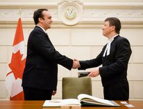 Kingston and the Islands Member of Parliament Mark Gerretsen, left, is congratulated by Andre Gagnon, deputy clerk of the House of Commons (Acting) after being sworn in on Thursday November 12 2015. Submitted Photo /The Whig-Standard/Postmedia Network