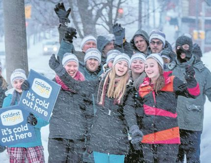 Submitted Photo Participants in the 2015 Coldest Night of the Year strike a pose during a heavy snowfall. The annual walk benefits Nightlight Belleville's drop-in centre in the downtown core.