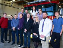 The London fire department recognized 13 Fanshawe College students who analyzed areas of the city where fires were high and came up with ways to educate people on prevention. From left are MacKenzie Huber, Chris Croucher, Marco Rogato, Russell Asciukiewicz, Cody Edwards, Cameron Higgins, Keena Martineau, Kirby Dykes, and Greg Langford. Back row, from left, Paul King, Alex Gazel, Cini Vastakis, and Alex Parreira. (MORRIS LAMONT, The London Free Press)