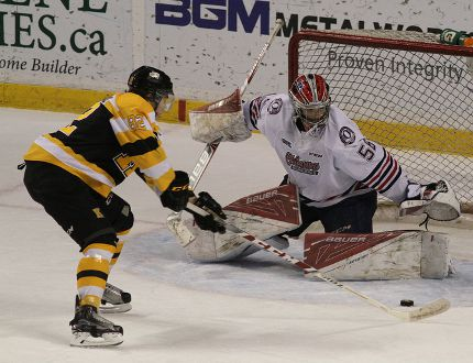 Kingston Frontenacs' Juho Lammikko tries a move on Oshawa Generals goalie Jeremy Brodeur during Ontario Hockey League action at the Rogers K-Rock Centre in Kingston on Friday. (Ian MacAlpine/The Whig-Standard)