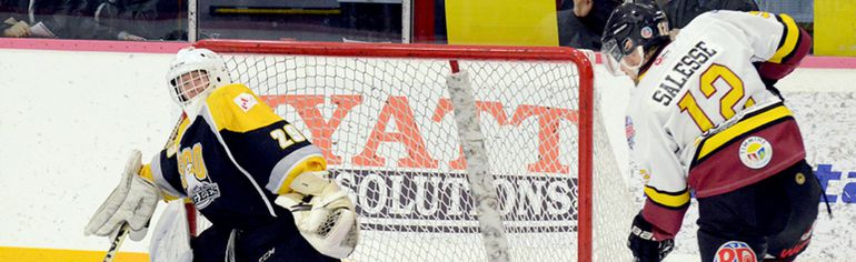 Timmins Rock forward Tristan Salesse has Soo Eagles goalie Jack Hickey at his mercy as he prepares to bury his 27th goal of the season during the first period of Friday night's NOJHL game at the McIntyre Arena. Salesse's goal gave the Rock a 4-2 lead, which they expanded to 6-2 prior to the end of the period, but they had to hang on to post an 8-6 victory.  THOMAS PERRY/THE DAILY PRESS