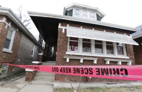 Crime scene tape surrounds a home Friday, Feb. 5, 2016, in Chicago. Chicago police are investigating what led to the deaths of two children, two women and two men whose bodies were found Thursday, with signs of trauma inside the home on the city's South Side. Chicago police Chief of Detective Eugene Roy said Friday morning that the victims appear to be from the same family. (AP Photo/M. Spencer Green)
