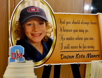 A moving tribute to Dasan Munro sits at the entrance to his funeral Saturday at South Grenville District High School. (RONALD ZAJAC/The Recorder and Times)
