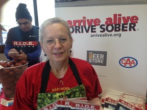 Anne Leonard, executive director of Arrive Alive DRIVE SOBER, works an education booth with tips on planning a safe Super Bowl Sunday at the Stockyards Beer Store on St. Clair Ave. W. (Kevin Connor, Toronto Sun)