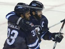 Dustin Byfuglien Andrew Ladd FILES Feb. 6/16