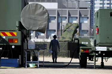 A Japanese Self-Defence Force's soldier walks between the unit of Patriot Advanced Capability-3 (PAC-3) missiles at Defense Ministry in Tokyo February 7, 2016. North Korea launched a long-range rocket on Sunday carrying what it has said is a satellite, South Korea's defense ministry said, in defiance of United Nations sanctions. REUTERS/Toru Hanai