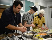 Ryan Paulsen / Daily Observer <br> Chef Garth Watterson, left, Ryan Gaudin and Savannah Thai work on preparing an Asian fusion Feast of the Farms for the Ottawa Valley Food Co-Operative's annual fundraising dinner, this year held at Pembroke's Calvin United Church on Saturday evening, Feb. 6.