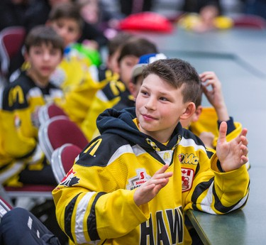 Meadowvale Hawks captain David Boddy, 10, at the Hershey Centre in Mississauga, Ont.  on Friday February 5, 2016. The Meadowvale Hawks presented Hunter Barnhardt, 9, who plays for the rival Cambridge Hawks  with Meadowvale's jersey and made a honourary member of their team and asked to join their practice. Ernest Doroszuk/Toronto Sun/Postmedia Network