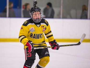 Hunter Barnhardt, 9, who plays for the Cambridge Hawks hockey team - wears a jersey for rival team Meadowvale Hawks - during a practice at the Hershey Centre in Mississauga, Ont.  on Friday February 5, 2016.  Barnhardt was presented with Meadowvale's jersey and made a honourary member of their team. Ernest Doroszuk/Toronto Sun/Postmedia Network