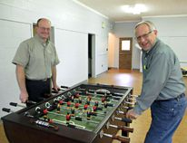 Pastors Al Sedgwick and Glenn Rider check one of the floor games as they set up rooms at Waterford Baptist Church for the new Youth Zone drop-in centre, which will host an open house on Family Day, Feb. 15. (Carol Steedman/For The Expositor)