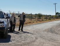 In this Saturday, Feb. 6, 2016 photo, Uvalde County Sheriffs Deputies guard the intersection to a neighborhood several miles outside of Uvalde, Texas. A 19-year-old killed his mother and two neighbors before turning his gun on himself in a shooting that brought SWAT and various emergency vehicles to a rural area, authorities said Sunday, Feb. 7. (Kin Man Hui, San Antonio Express-News via AP)