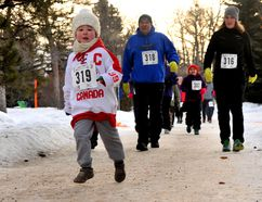 James Brausen-Ward, at front, of Grande Prairie, Alta, runs in the second annual Chilly Willy Winter Run as Ray Brausen and Sarah Brausen follow on Sunday February 7, 2016 at Muskoseepi Park in Grande Prairie, Alta. The event included a 21k and 10k run, as well as a 5k run and walk. Logan Clow/Grande Prairie Daily Herald-Tribune/Postmedia Network